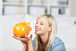 A-lady-holding-her-piggy-bank-to-signify-savings
